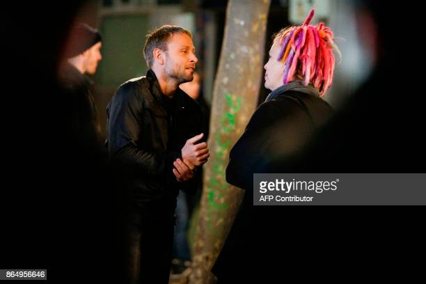 German actor Max Riemelt talks with US director Lana Wachowski on the set of Netflix TV scifi series Sense8 in the Montmartre area of Paris on...