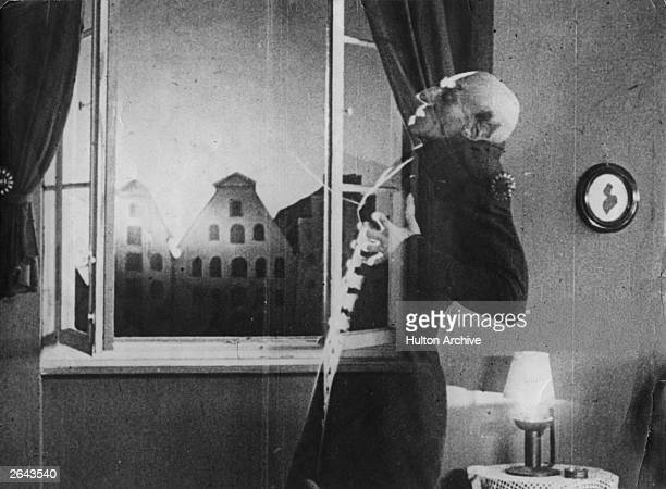 German actor Max Schreck as the vampire Count Orlok being destroyed by sunlight in a still from F W Murnau's expressionist horror film 'Nosferatu...