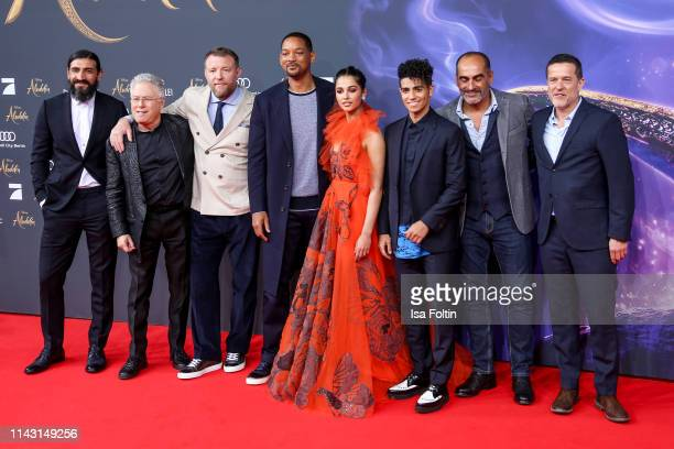 German actor Numan Acar US composer Alan Menken British director Guy Ritchie US actor and singer Will Smith British actress and singer Naomi Scott...