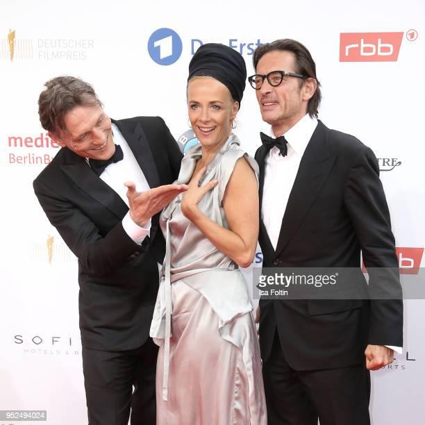 German actor Oliver Masucci German actress Katja Riemann and director Oskar Roehler attend the Lola German Film Award red carpet at Messe Berlin on...
