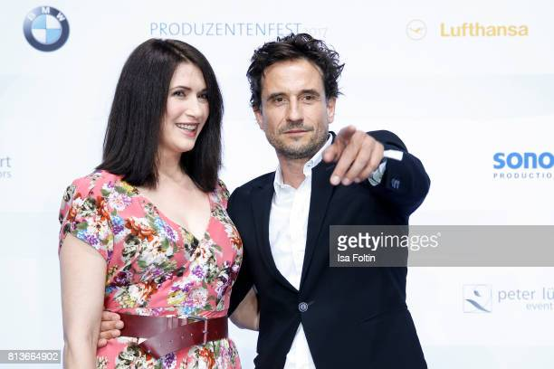 German actor Oliver Mommsen and guest attend the summer party 2017 of the German Producers Alliance on July 12 2017 in Berlin Germany