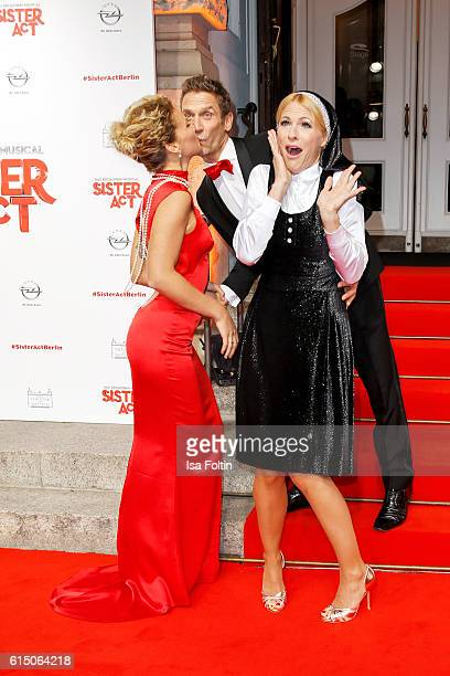 German actor Peer Kusmagk and his girlfriend Janni Hoenscheid and german moderator Sonya Kraus disguised as nun attend the 'Sister Act: The Musical'...