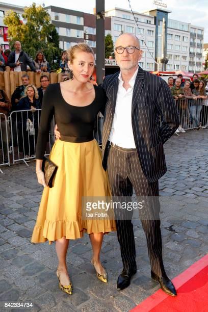 German actor Peter Lohmeyer and his girlfriend Leonie Seifert attend the 'Nacht der Legenden' at Schmidts Tivoli on September 3 2017 in Hamburg...