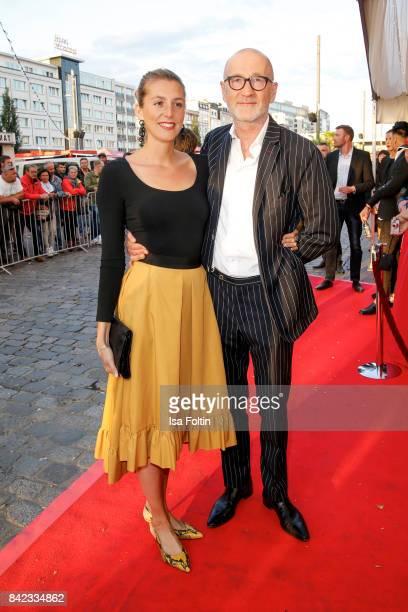 German actor Peter Lohmeyer and his girlfriend Leonie Seifert attend the 'Nacht der Legenden' at Schmidts Tivoli on September 3, 2017 in Hamburg,...