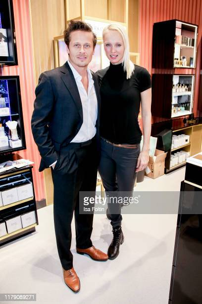 German actor Roman Knizka and his girlfriend dancer Nele Hermann attends the Douglas FlagshipStore Opening on October 30 2019 in Berlin Germany