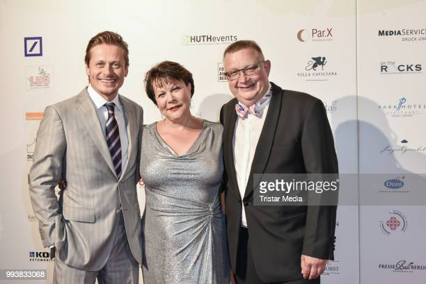German actor Roman Knizka Marina Reimer and her husband Lutz Reimer during the Aline Reimer Foundation Gala on July 7 2018 in Berlin Germany
