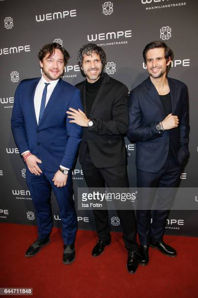 German actor Ronald Zehrfeld actor Pasquale Aleardi and german actor Tom Beck attend the Wempe store opening with the Rolls Royce shuttels in front...