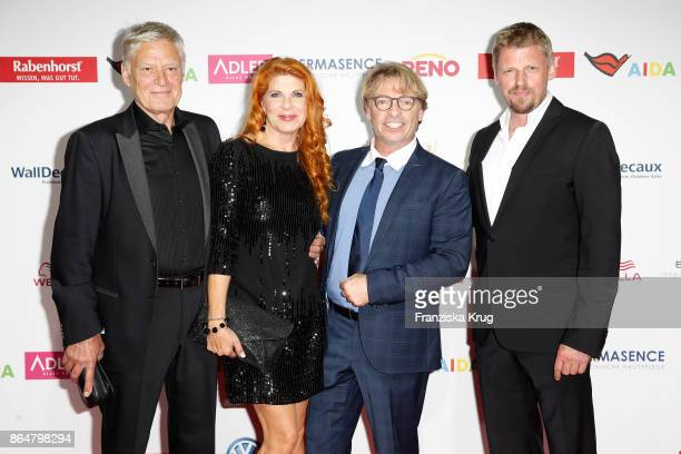 German actor Ruediger Joswig with his wife German actress Claudia Wenzel German actor Andre Eisermann and German actor Martin Gruber attends the...