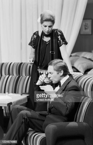 German actor singer and entertainer Harald Juhnke playing in a sketch with Johanna von Koczian Germany circa 1980