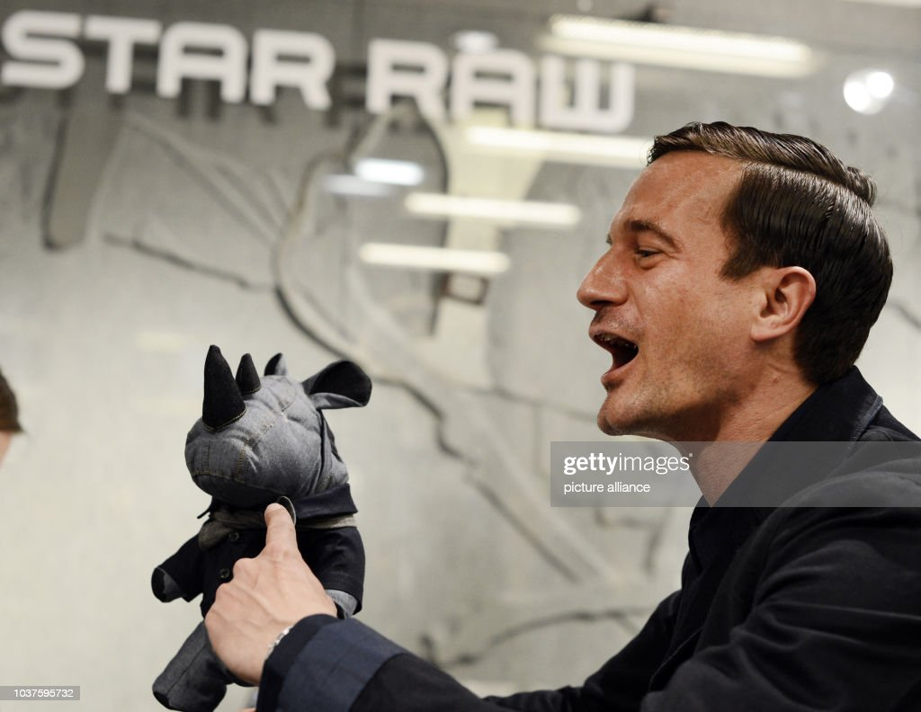 German actor Soenke Moehring poses with a mascot during the Grand ...