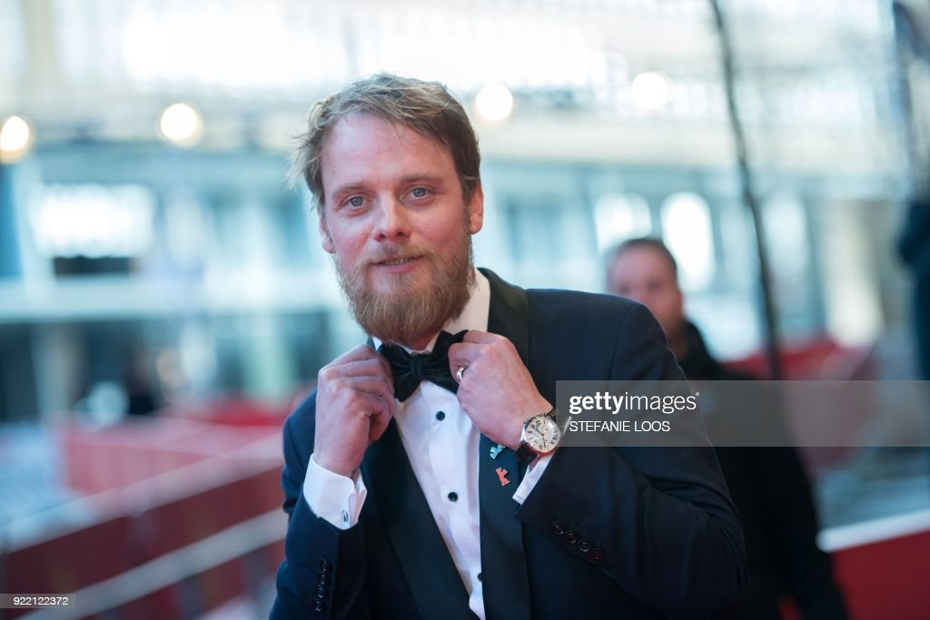 German actor Stefan Konarske poses on the red carpet before the premiere of the film 'My Brother's Name is Robert and He is an Idiot' (Mein Bruder heisst Robert und ist ein idiot) presented in competition during the 68th edition of the Berlinale film festival in Berlin on February 21, 2018. / AFP PHOTO / Stefanie LOOS