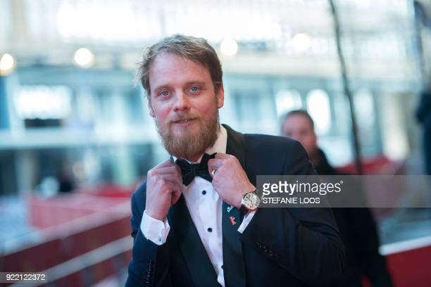German actor Stefan Konarske poses on the red carpet before the premiere of the film 'My Brother's Name is Robert and He is an Idiot' presented in...