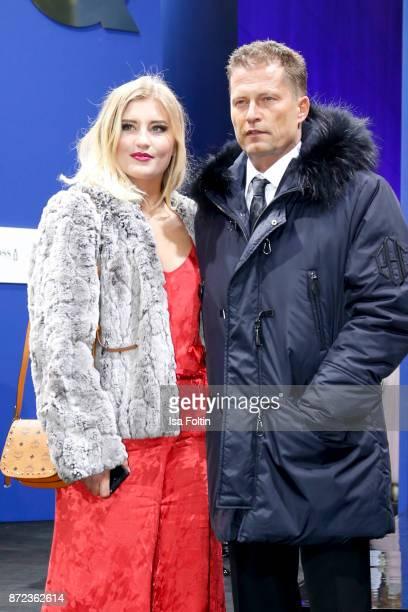 German actor Til Schweiger and his daughter Luna Schweiger arrive for the GQ Men of the year Award 2017 at Komische Oper on November 9 2017 in Berlin...