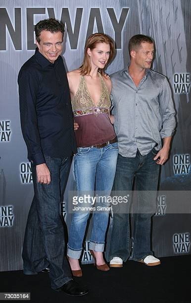 German actor Til Schweiger Canadian actress Lauren Lee Smith and producer Thomas Zickler pose at the photocall of One Way at the Hotel Bayerischer...