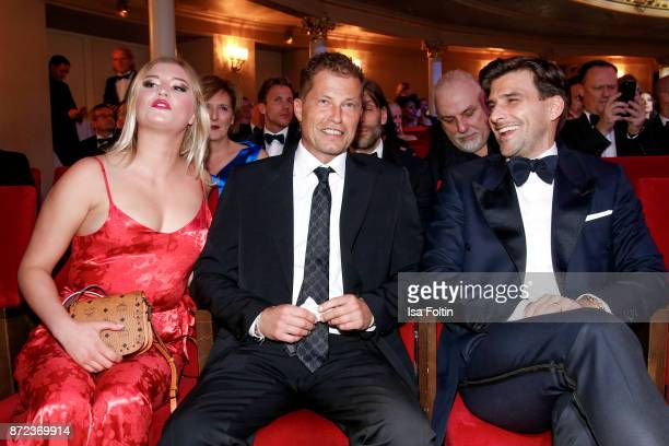 German actor Til Schweiger with his daughter Luna Schweiger and model and influencer Johannes Huebl during the GQ Men of the year Award 2017 show at...