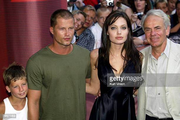 German actor Til Schweiger with his son Valentine actress Angelina Jolie and director Jan De Bont pose for photographers at the premiere of her new...