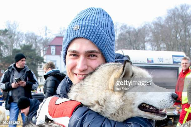 German actor Timothy Boldt plays with a sled dog during the 'Baltic Lights' charity event on March 10 2018 in Heringsdorf Germany The annual event...