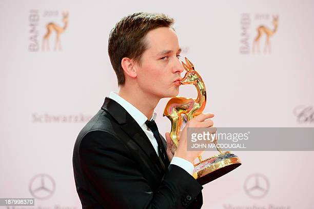 German actor Tom Schilling poses after receiving his Bambi award at the Stage theatre at Potsdamer Platz in Berlin on November 14 2103 The awards...
