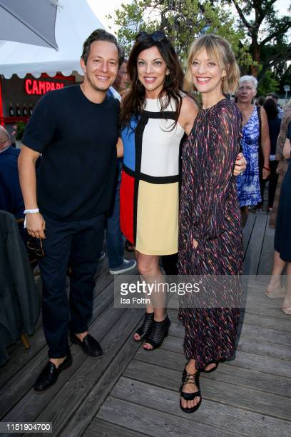 German actor Trystan Puetter, producer Alice Brauner and German actress Heike Makatsch attend the summer party of the German Producers Alliance on...