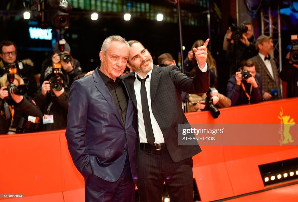 TOPSHOT - German actor Udo Kier (L) and US actor Joaquin Phoenix pose on the red carpet for the premiere of the film 'Don't Worry, He Won't Get Far on Foot' presented in competition during the 68th edition of the Berlinale film festival in Berlin on February 20, 2018. / AFP PHOTO / Stefanie Loos