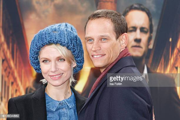 German actor Vinzenz Kiefer and his girlfriend Masha Tokareva attend the German premiere of the film 'INFERNO' at Sony Centre on October 10 2016 in...
