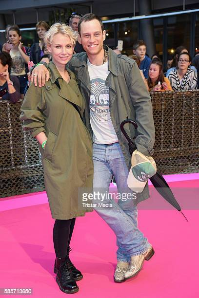 German actor Vinzenz Kiefer and his wife Masha Tokareva attend the Suicide Squad Live Event at CineStar on August 3, 2016 in Berlin, Germany.