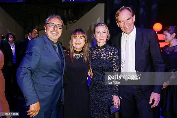 German actor Wolfgang Stumph with his wife Christine Stumph and Leipzig major Burkhard Jung and his wife Ayleena Jung during the aftershow party at...