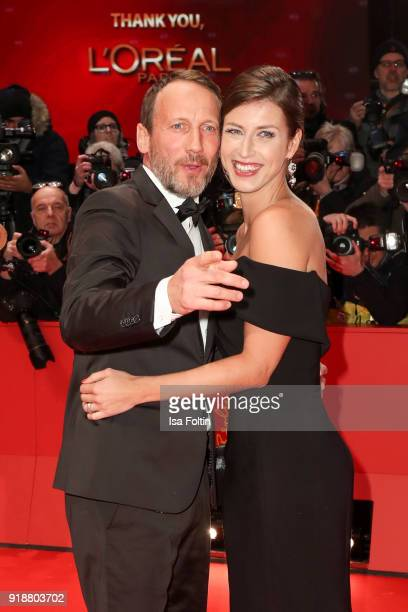 German actor Wotan Wilke Moehring and his partner Cosima Lohse attend the Opening Ceremony 'Isle of Dogs' premiere during the 68th Berlinale...