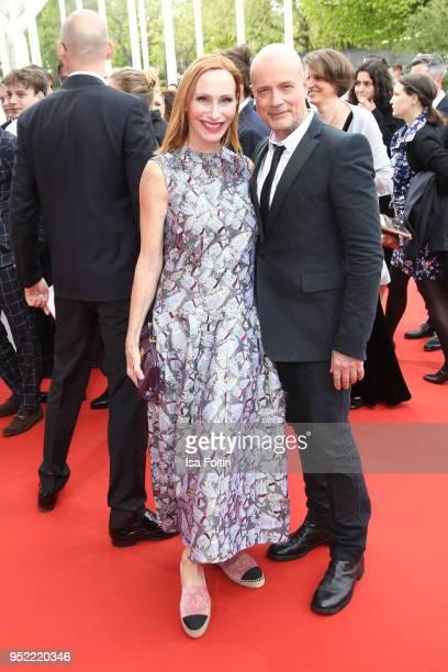 German actors Andrea Sawatzki and Christian Berkel attend the Lola German Film Award red carpet at Messe Berlin on April 27 2018 in Berlin Germany