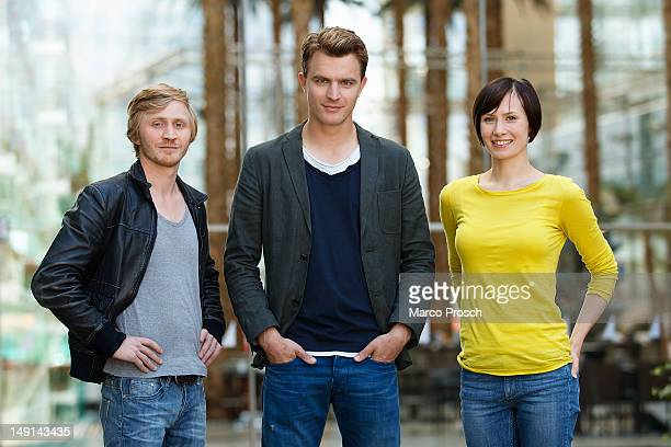 German actors Benjamin Kramme Friedrich Muecke and Alina Levshin pose for the camera after being announced as the new Thueringen Tatort crew on July...