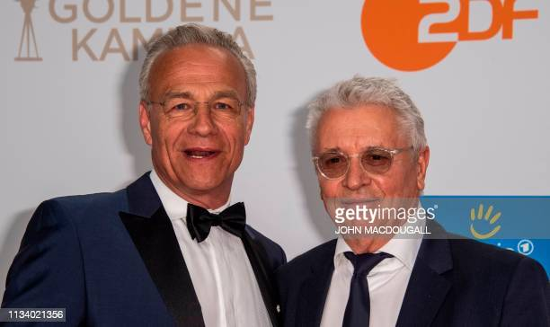 German actors Klaus Behrendt and Henry Huebchen pose on the red carpet prior to the annual German film and television awards 'Golden Camera' of...