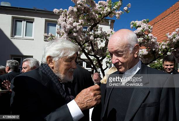German actors Mario Adorf and Armin Mueller-Stahl attend a reception in the garden of the Guenter Grass House, which is dedicated German Nobel prize...