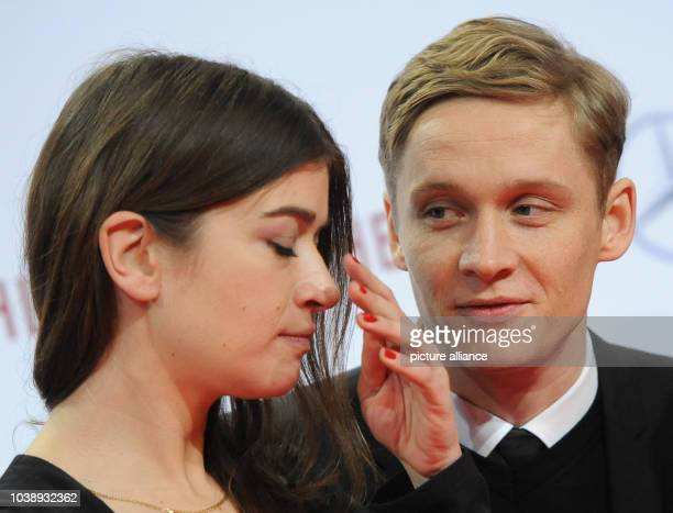 German actors Matthias Schweighoefer and Anna Bederke arrive for the premiere of their new film 'Schlussmacher' in Berlin Germany 7 January 2013 The...