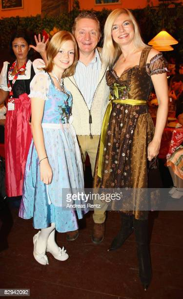 German actors Michaela Merten her husband Pierre Franckh and daughter Julia attend a party at Hippodrom beer tent during day 2 of Oktoberfest beer...