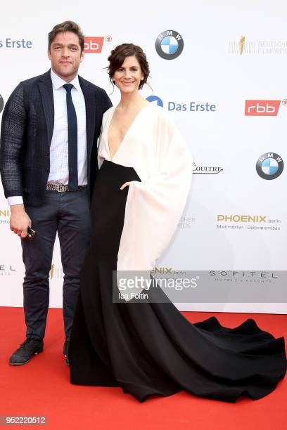 German actors Ronald Zehrfeld and Christina Hecke attend the Lola German Film Award red carpet at Messe Berlin on April 27 2018 in Berlin Germany