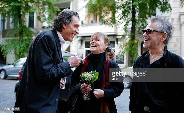German actors Winfried Glatzeder talks to Angelica Domroese and her husband Hilmar Thate before the screening of the former East German classic film...