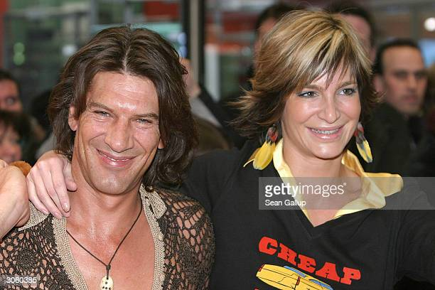 "German actress Alexandra Kamp and her friend, actor Tertius Meintjes, attend the European premiere of ""Starsky And Hutch"" on March 9, 2004 in Munich,..."