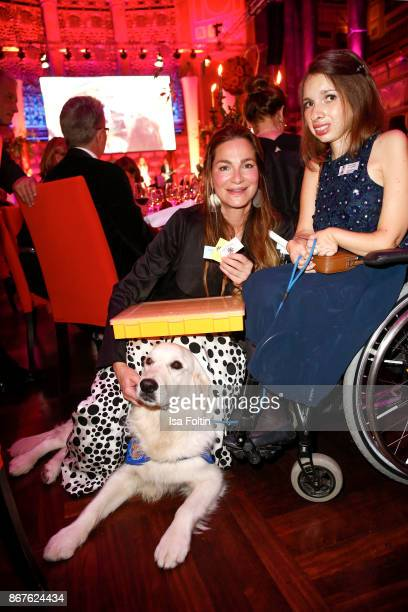 German actress Alexandra Kamp with the VitaTeam Pauline Bader and her dog Quandace during the 8th VITA Charity Gala on October 28 2017 in Wiesbaden...