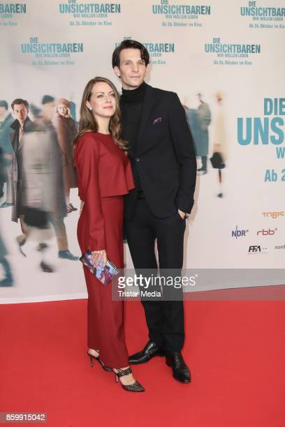 German actress Alice Dwyer and her boyfriend German actor Sabin Tambrea attend the 'Die Unsichtbaren' Premiere at Kino International on October 10...