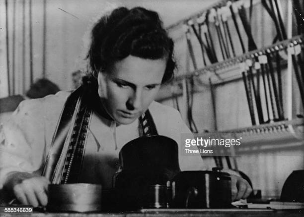 German actress and director Leni Riefenstahl pictured at work in the cutting room, circa 1935.
