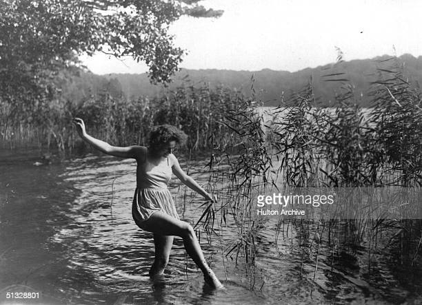 German actress and film director Leni Riefenstahl paddling in a lake mid 1920s