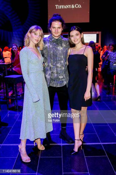 German actress and singer Lina Larissa Strahl and her boyfriend German actor Tilman Poerzgen with German actress Caroline Hartig attend the annual...