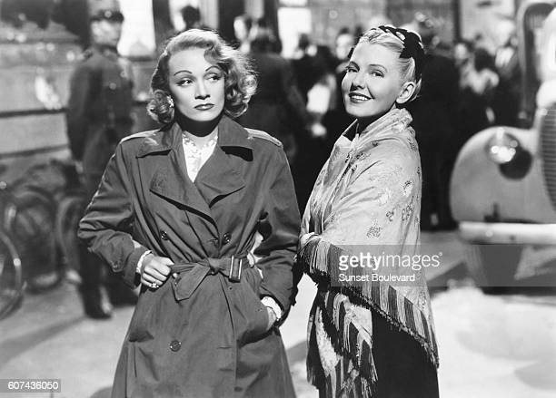 German actress and singer Marlene Dietrich and American actress Jean Arthur on the set of A Foreign Affair written and directed by Billy Wilder