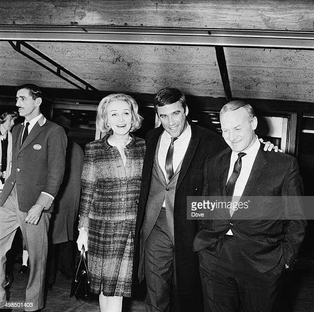 German actress and singer Marlene Dietrich at London Airport to welcome American composer Burt Bacharach to the UK 21st November 1964