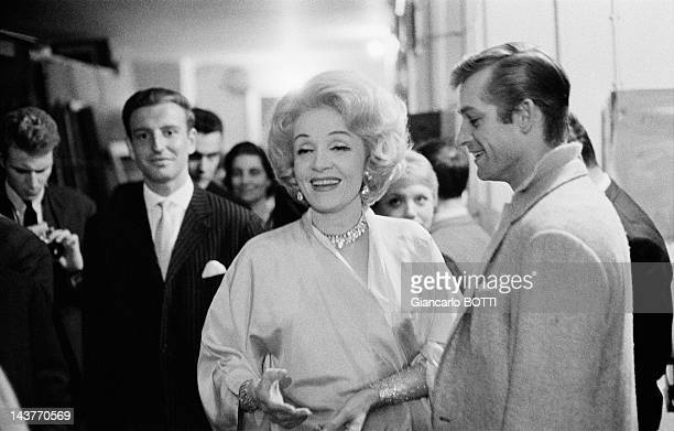 German actress and singer Marlene Dietrich with fans during her performance at the Olympia during May 1962 in ParisFrance
