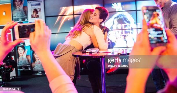 German actress and singer Martina 'Tini' Stoessel hugs a fan in Hamburg Germany 28 February 2017 Photo Daniel Bockwoldt/dpa | usage worldwide