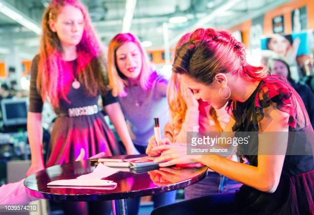German actress and singer Martina 'Tini' Stoessel signs autographs for fans in Hamburg Germany 28 February 2017 Photo Daniel Bockwoldt/dpa | usage...