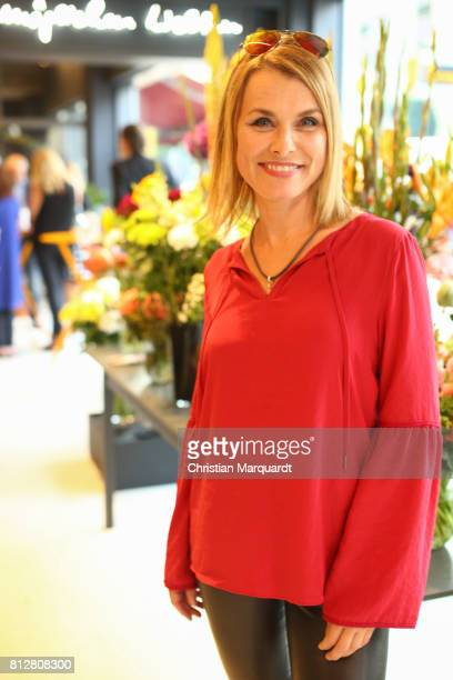 German actress Andrea Luedke attends the 'Kians Garden Flower Shop' Opening Event at Kantstrasse on July 11 2017 in Berlin Germany