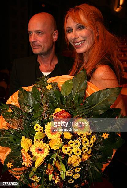 German actress Andrea Sawatzki and actor Christian Berkel pose after the annual Corine awards on September 16, 2007 in Munich, Germany. The Corine...
