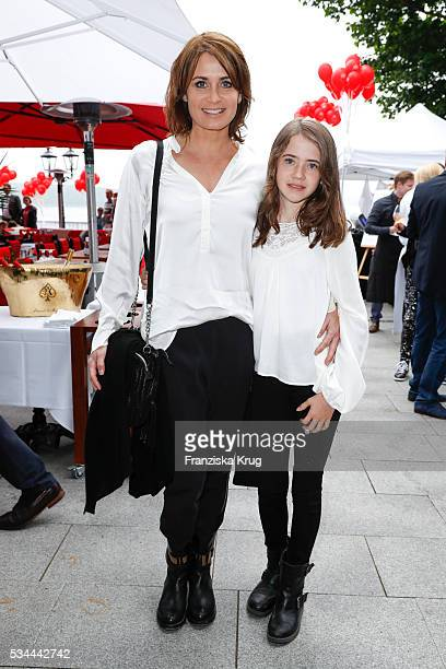 German actress Anja Kling and her daughter Alea during the 'Ein Herz fuer Kinder' summer party at Wannseeterrassen on May 26, 2016 in Berlin, Germany.